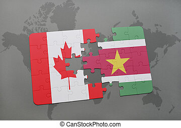 puzzle with the national flag of canada and suriname on a world map background.