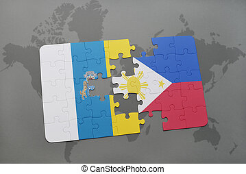 puzzle with the national flag of canary islands and philippines on a world map background.