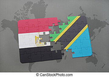 puzzle with the national flag of egypt and tanzania on a world map.
