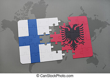 puzzle with the national flag of finland and albania on a world map background.