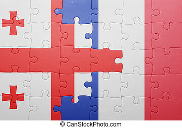 puzzle with the national flag of georgia and france
