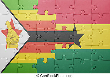 puzzle with the national flag of ghana and zimbabwe