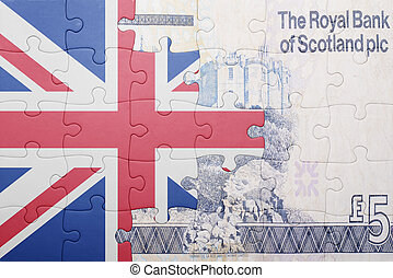 puzzle with the national flag of great britain and scottish banknote