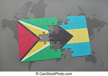 puzzle with the national flag of guyana and bahamas on a world map background.