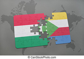 puzzle with the national flag of hungary and comoros on a world map
