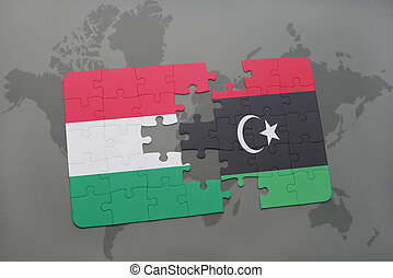 puzzle with the national flag of hungary and libya on a world map