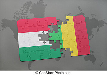 puzzle with the national flag of hungary and mali on a world map