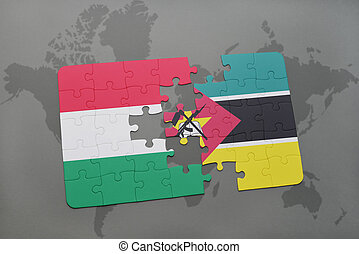 puzzle with the national flag of hungary and mozambique on a world map