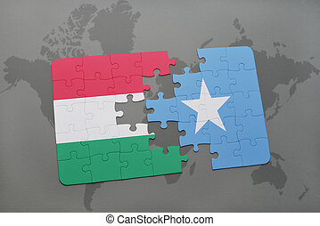 puzzle with the national flag of hungary and somalia on a world map