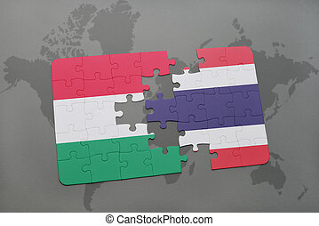 puzzle with the national flag of hungary and thailand on a world map