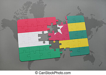 puzzle with the national flag of hungary and togo on a world map