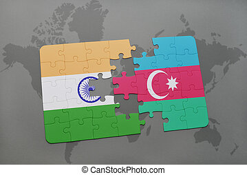 puzzle with the national flag of india and azerbaijan on a world map background.