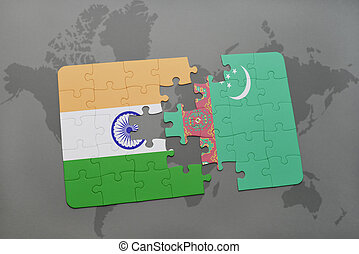 puzzle with the national flag of india and turkmenistan on a world map background.
