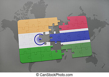 puzzle with the national flag of india and gambia on a world map background.