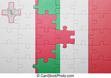 puzzle with the national flag of italy and malta