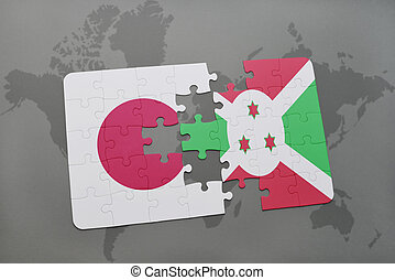puzzle with the national flag of japan and burundi on a world map background.