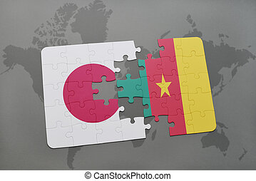 puzzle with the national flag of japan and cameroon on a world map background.