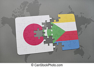 puzzle with the national flag of japan and comoros on a world map background.