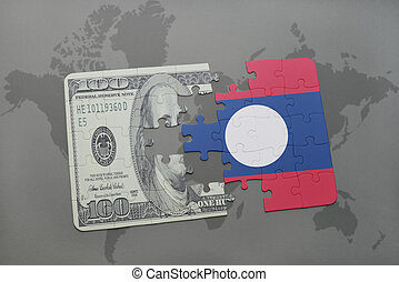puzzle with the national flag of laos and dollar banknote on a world map background.