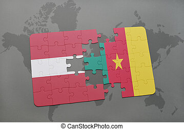 puzzle with the national flag of latvia and cameroon on a world map