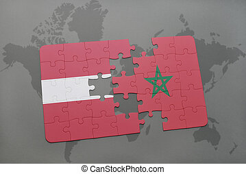 puzzle with the national flag of latvia and morocco on a world map