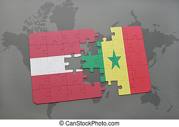 puzzle with the national flag of latvia and senegal on a world map