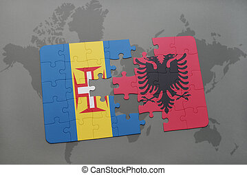 puzzle with the national flag of madeira and albania on a world map background.