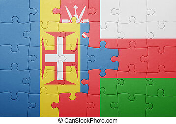 puzzle with the national flag of madeira and oman