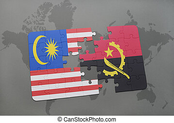 puzzle with the national flag of malaysia and angola on a world map background.