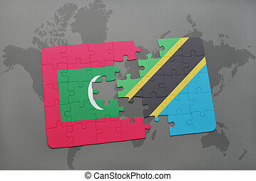 puzzle with the national flag of maldives and tanzania on a world map