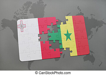 puzzle with the national flag of malta and senegal on a world map