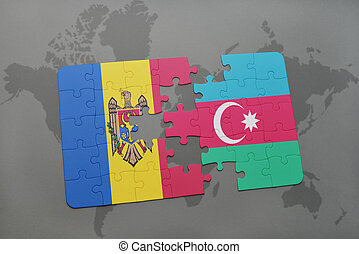 puzzle with the national flag of moldova and azerbaijan on a world map background.