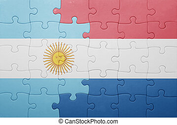 puzzle with the national flag of netherlands and argentina...