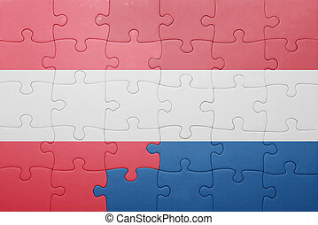 puzzle with the national flag of netherlands and austria . ...