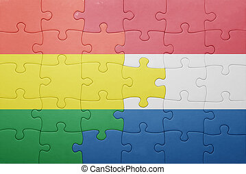 puzzle with the national flag of netherlands and bolivia . ...