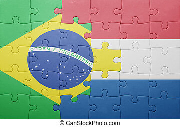 puzzle with the national flag of netherlands and brazil . ...