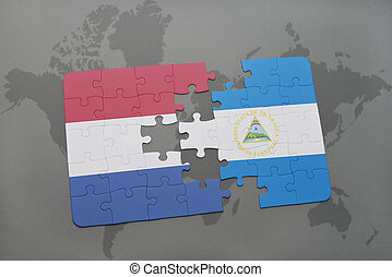 puzzle with the national flag of netherlands and nicaragua ...