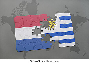 puzzle with the national flag of netherlands and uruguay on ...