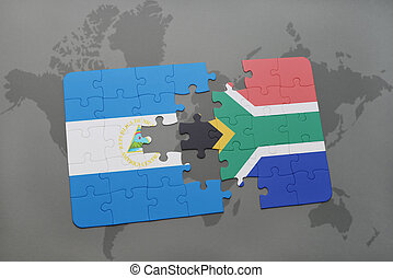 puzzle with the national flag of nicaragua and south africa on a world map