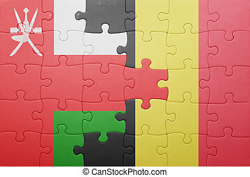 puzzle with the national flag of oman and belgium