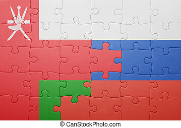 puzzle with the national flag of oman and russia