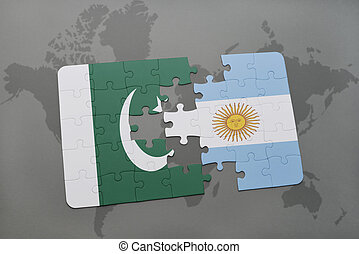puzzle with the national flag of pakistan and argentina on a world map background.