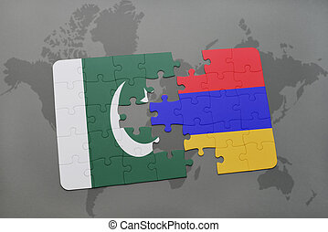 puzzle with the national flag of pakistan and armenia on a world map background.