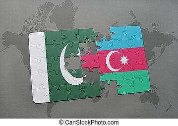 puzzle with the national flag of pakistan and azerbaijan on a world map background.