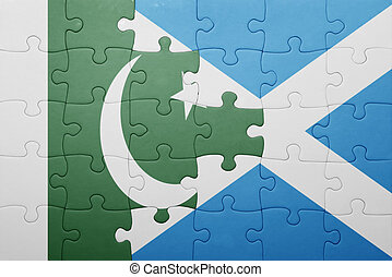 puzzle with the national flag of pakistan and scotland . ...
