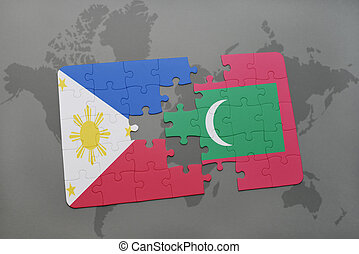 puzzle with the national flag of philippines and maldives on a world map background.