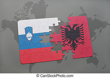 puzzle with the national flag of slovenia and albania on a world map background.