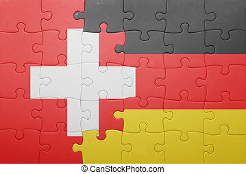 puzzle with the national flag of switzerland and germany