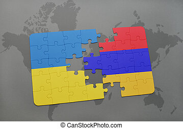 puzzle with the national flag of ukraine and armenia on a world map background.