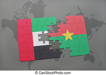 puzzle with the national flag of united arab emirates and burkina faso on a world map